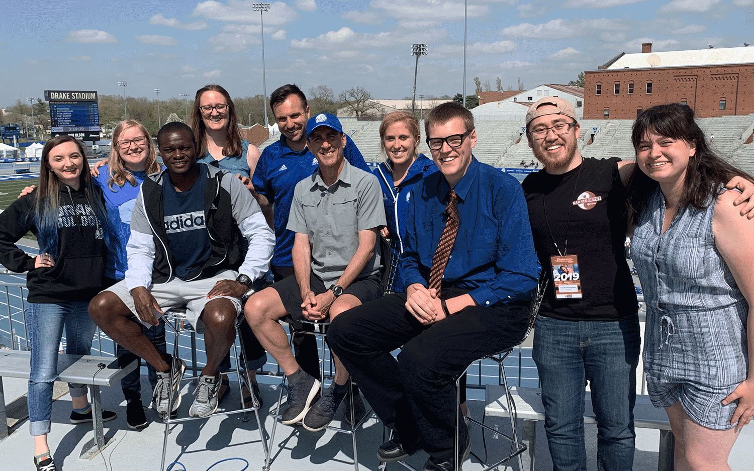 DBS Relays Show 2 crew and guests smiling at Drake Stadium